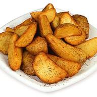 Картофельные дольки со специями Фото