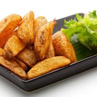 Картофель фри в деревенском стиле Фото