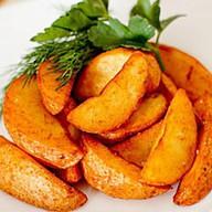 Картофельные дольки запеченные с соусом Фото