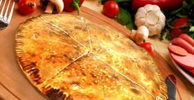 Закрытая пицца с курицей - Фото