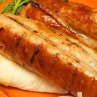 Барбекю из свиных колбасок Фото