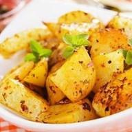 Картофельные дольки запечен Фото