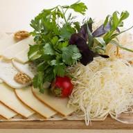 Ассорти домашних сыров Фото