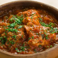 Чахохбили - кусочки цыпленка в соусе Фото