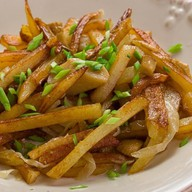 Картофель, обжаренный с белыми грибами Фото