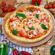 Пицца с лососем и креветками Фото