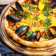 Пицца с морепродуктами том ям Фото