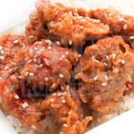 Свинина в кисло-сладком соусе Фото