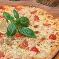 Том-Ям с морепродуктами пицца Фото