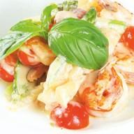 Соте из морепродуктов с томатами Фото