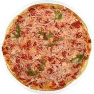 Пицца с ветчиной и сыром Фото