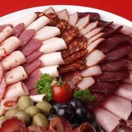 Мясные деликатесы Фото