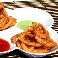 Хрустящие кольца кальмаров Фото