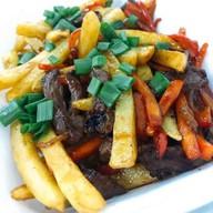 Картофель фри с говядиной Фото