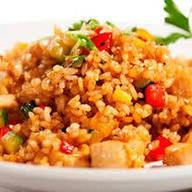 Рис со свининой и овощями Фото