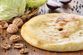 Осетинский пирог с капустой и орехом - Фото