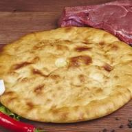 Осетинский пирог с мясом и капустой Фото