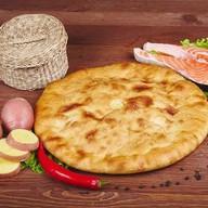 Осетинский пирог с рыбой и картофелем Фото