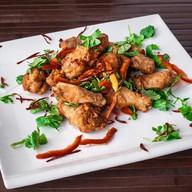Куриные крылышки с луком,кинзой,перцем Фото