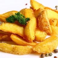 Картофель дольками Фото