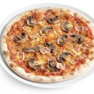 Пицца ветчина и грибы ланч Фото