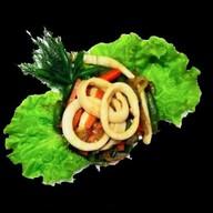 Кальмары обжаренные с овощами Фото