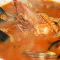 Рыбный суп с морепродуктами Фото