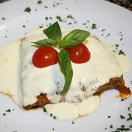 Баклажаны с сыром таледжио Фото