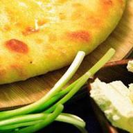 Пирог с сыром и луком Кадындзджи Фото