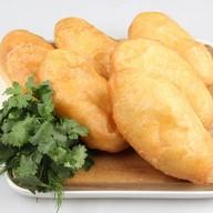 Пирожок с картофелем и зеленью Фото