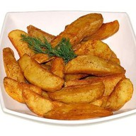 Картофель по деревенски Фото