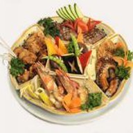 Ассорти из горячих блюд рыбное Фото