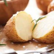 Картофель, печеный на углях Фото