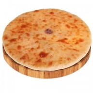 Осетинский пирог c сыром и зелёным луком Фото