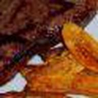 Стейк из свинины жареный на гриле Фото