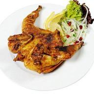 Цыпленок на углях Фото