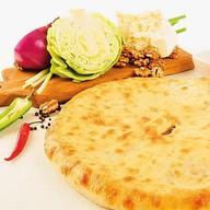 Пирог с мясом и тушеной капустой Фото