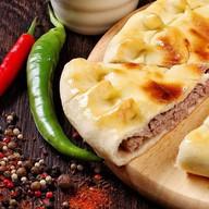 Пирог с рубленым мясом традиционный Фото