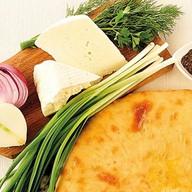 Пирог с сыром, капустой и зеленым луком Фото