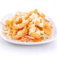 Кальмары в сливочном соусе Фото