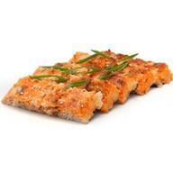Суши-пицца с креветками, мидиями и сыром Фото