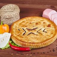 Осетинский пирог с сыром и ветчиной Фото
