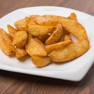 Картофельные дольки в специях Фото