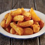 Картофельные дольки с кетчупом Фото