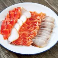 Тарелка рыбных деликатесов Фото