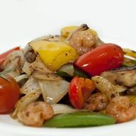 Горячий салат из морепродуктов Фото