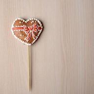 Пряник сувенирный Сердце бантик Фото