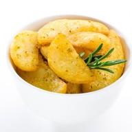 Картофельные дольки по-средиземноморски Фото