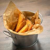 Картофельные дольки с пармезаном Фото