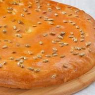 Пирог осетинский с капустой,сыром,орехом Фото